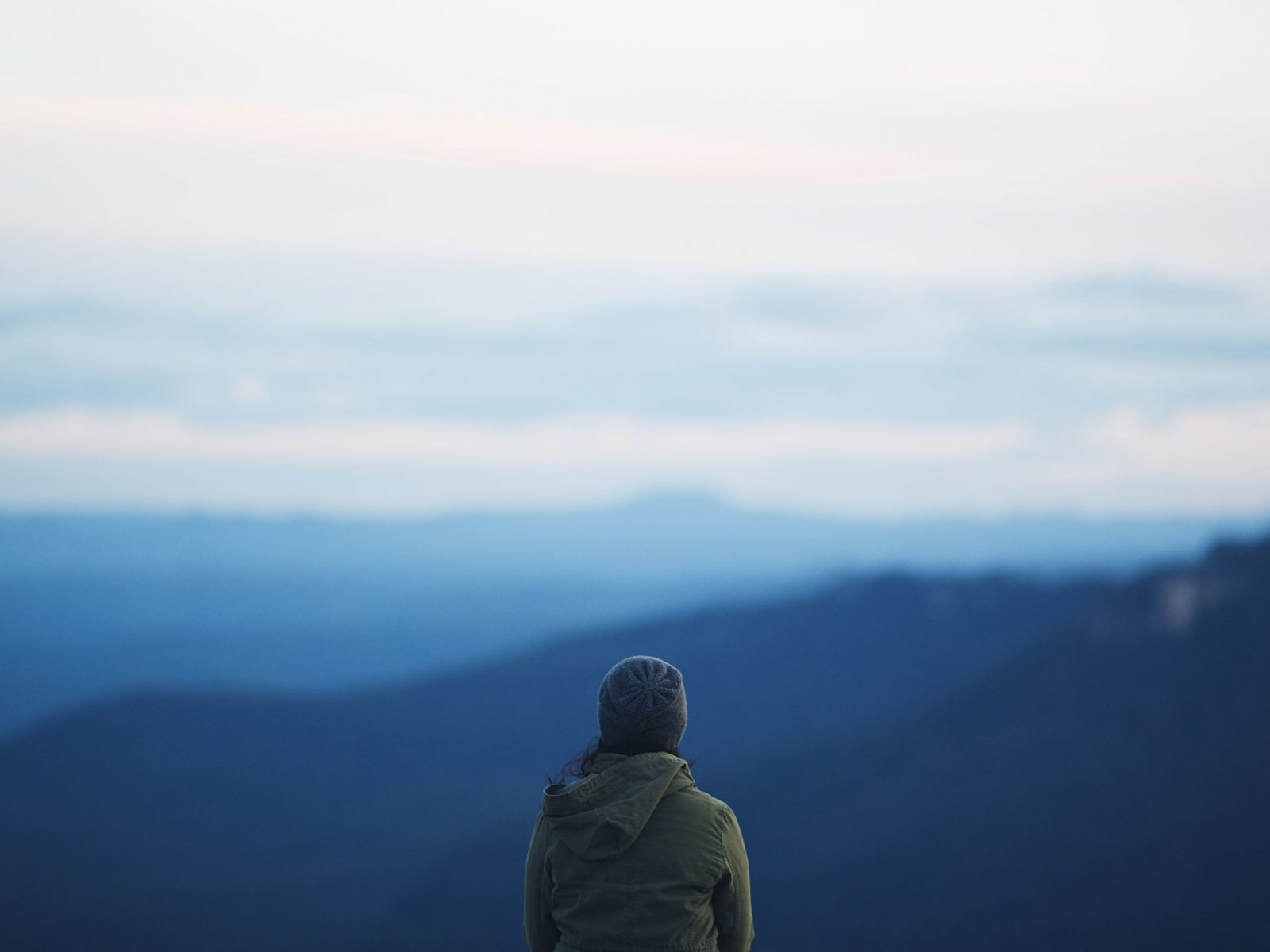 Person overlooking the blue mountains backdrop