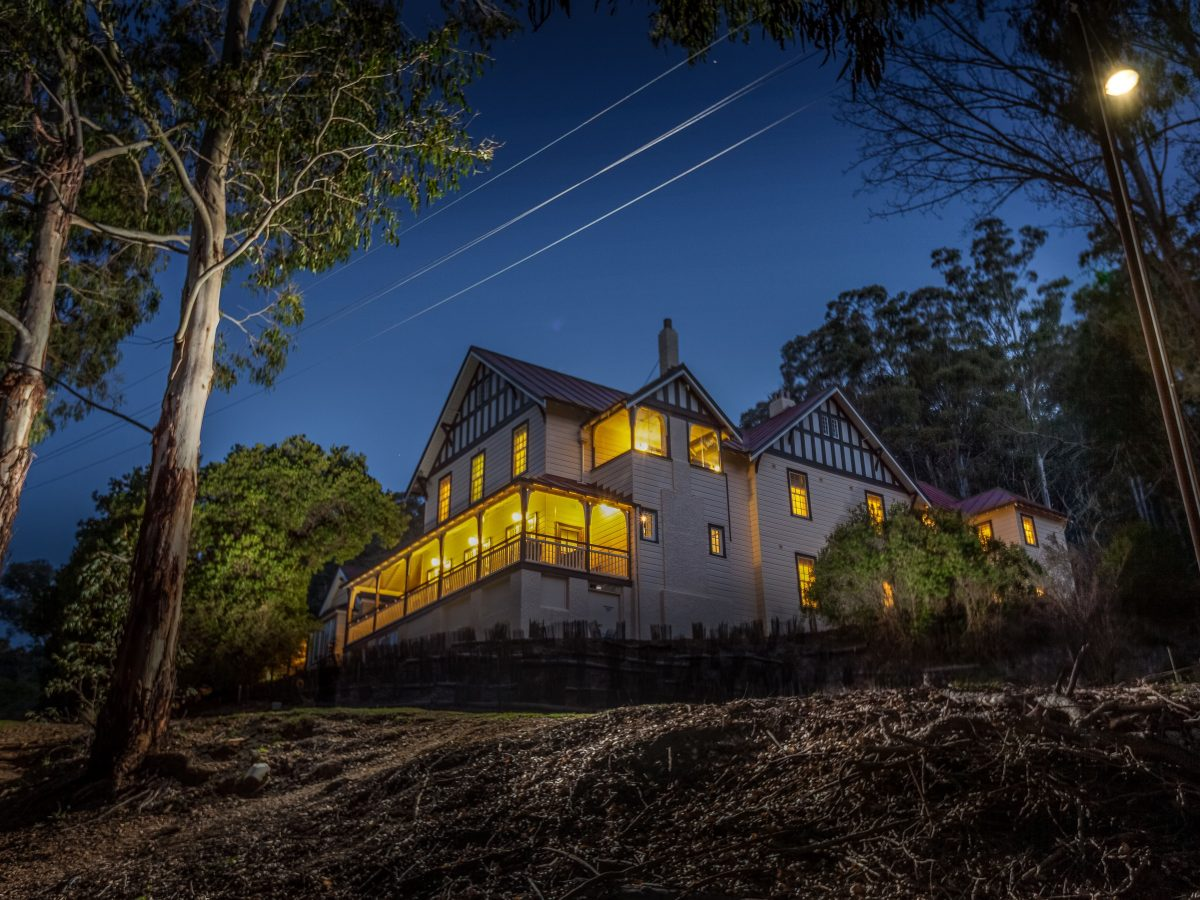 Large heritage house at dusk, Yarrangobilly Caves House