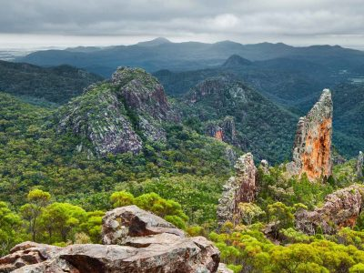 The Breadknife, a 90m-high rock wall sticking out from bushland in Warrumbungle National Park