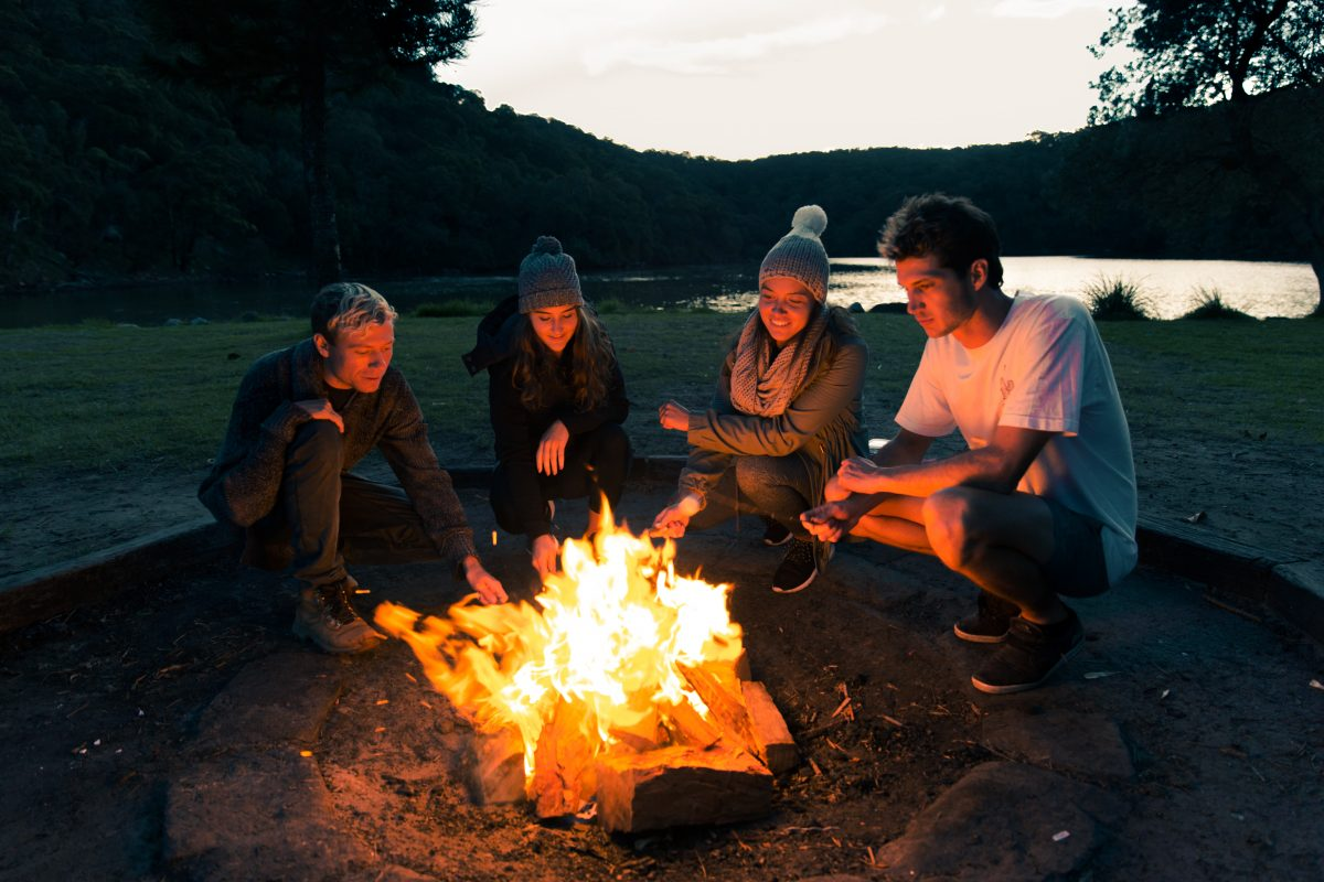 Group around a campfire at The Basin campground in Ku-ring-gai Chase National Park. Photo: Tim Clark/OEH