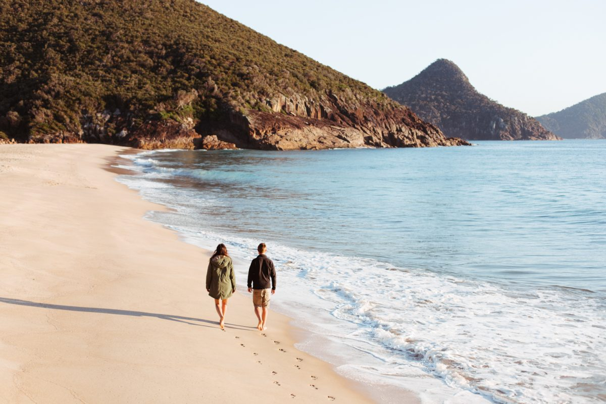Two people walking along the beach, Ku-ring-gai Chase National Park. Photo: Tim Clark