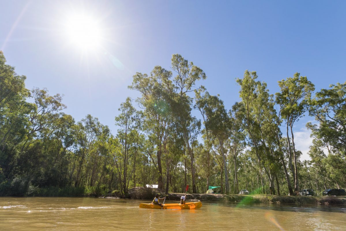 Father and daughter canoeing at Swifts Creek campground on the Murray River