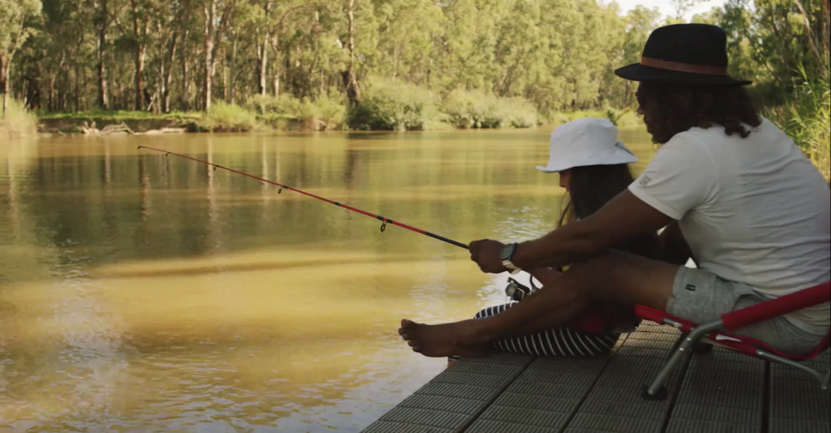 People fishing on the Murray River Swifts Creek campground