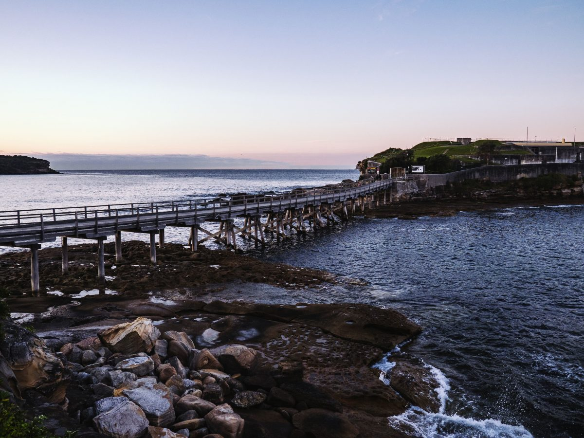 Sunset over Bare Island and the rocky foreshore