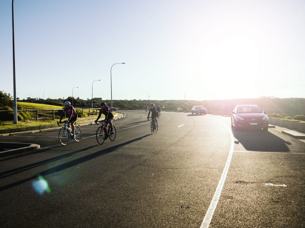People cycling the 'La Per Loop' road in the sunshine