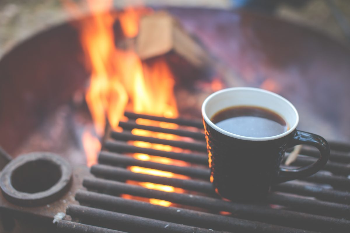 Coffee mug next to campfire