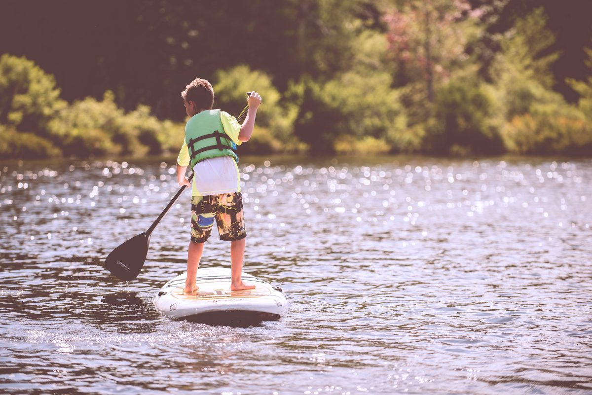 Kid paddleboarding on the Murray River