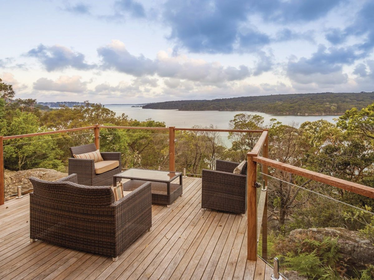 Outdoor chairs with water views, Hilltop Cottage