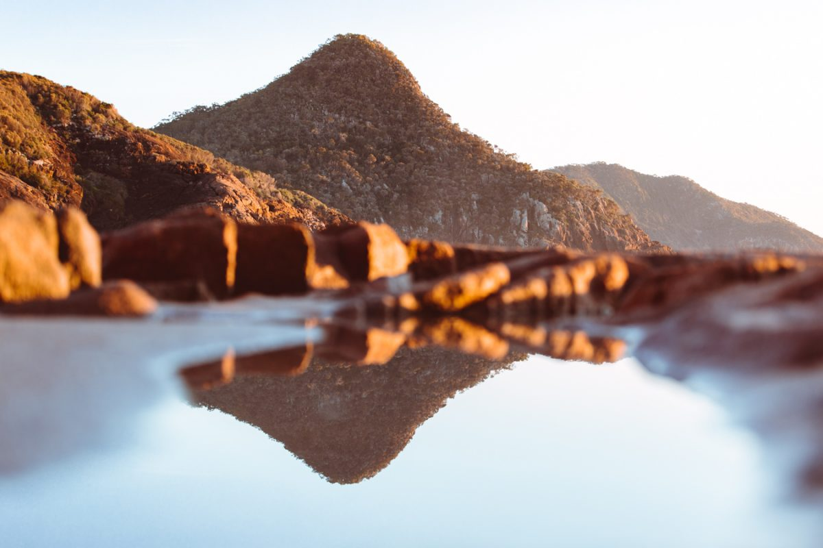 Rock pool reflections of a mountain