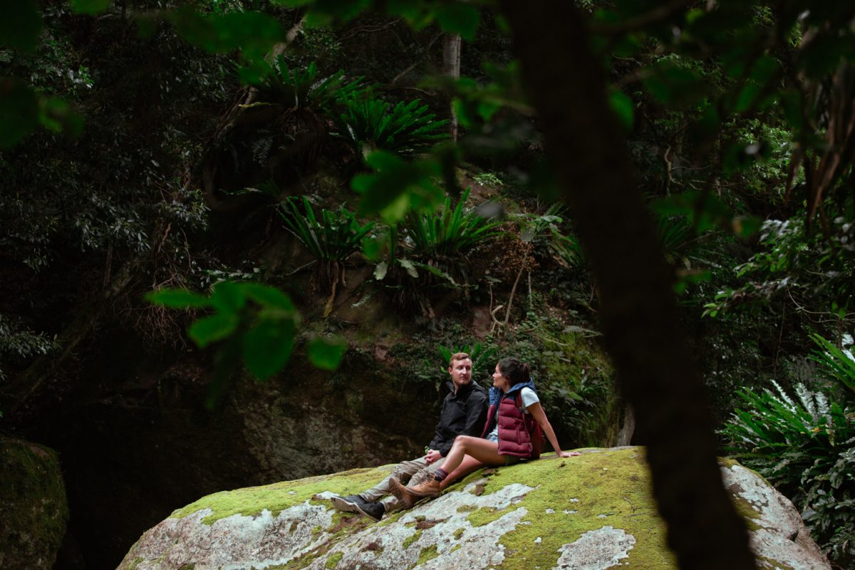 Couple relaxing on a large rock