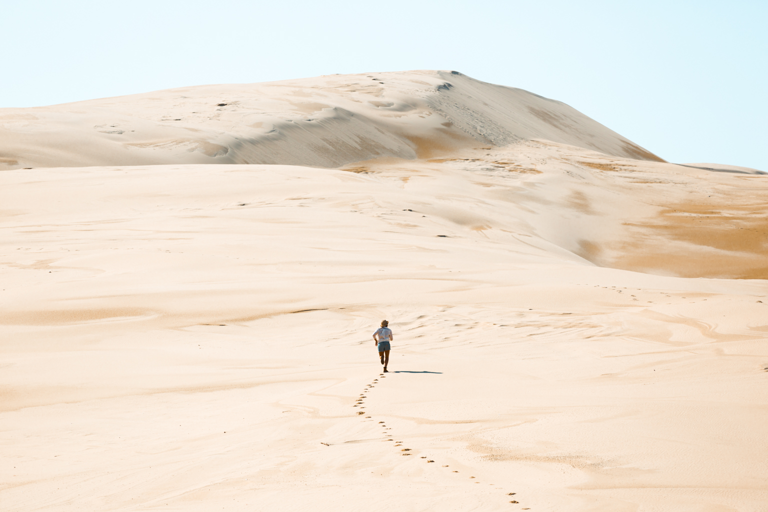 Person running up the Stockton Sand Dunes