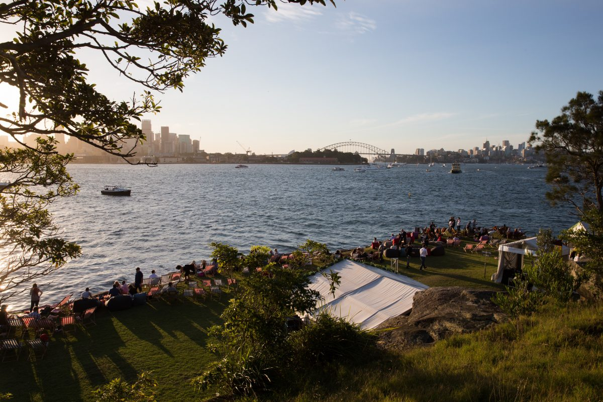 People relaxing before the Sydney Harbour New Year's Eve fireworks at Clark Island, Sydney Harbour National Park. Photo: Edwina Pickles/DPIE