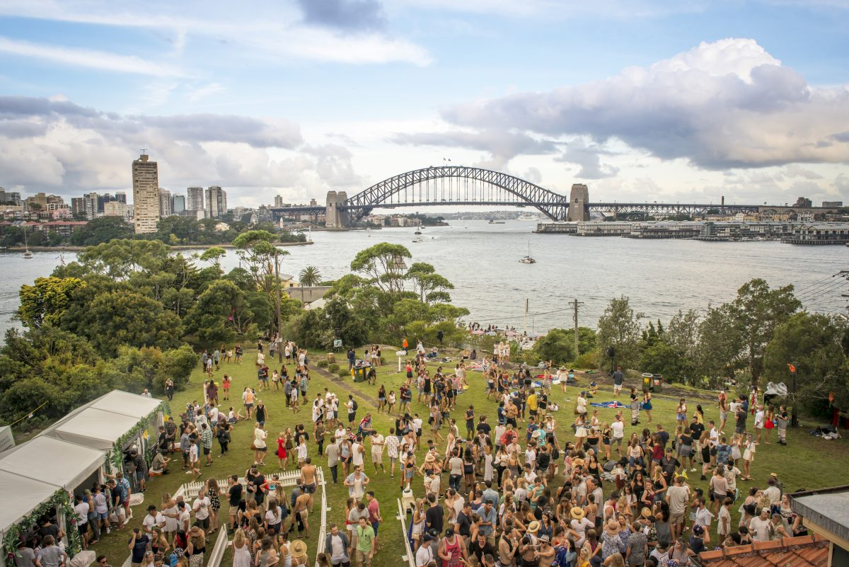 People relaxing before the Sydney Harbour New Year's Eve fireworks at Goat Island, Sydney Harbour National Park. Photo: John Spencer/DPIE