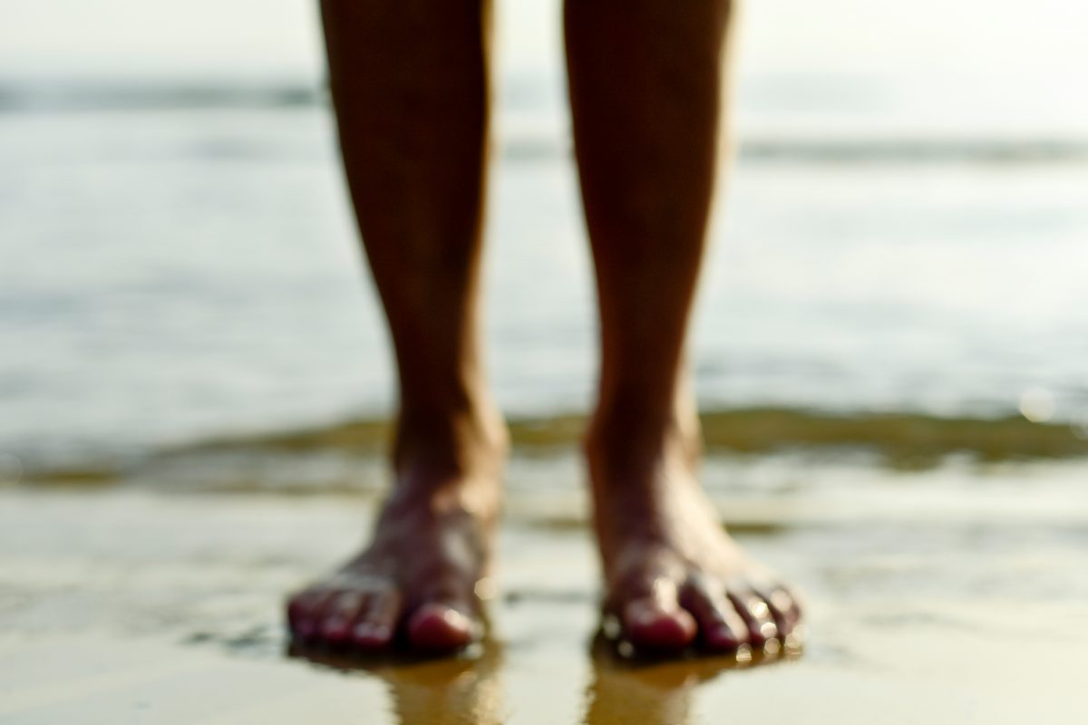 Generic image of feet in the sand