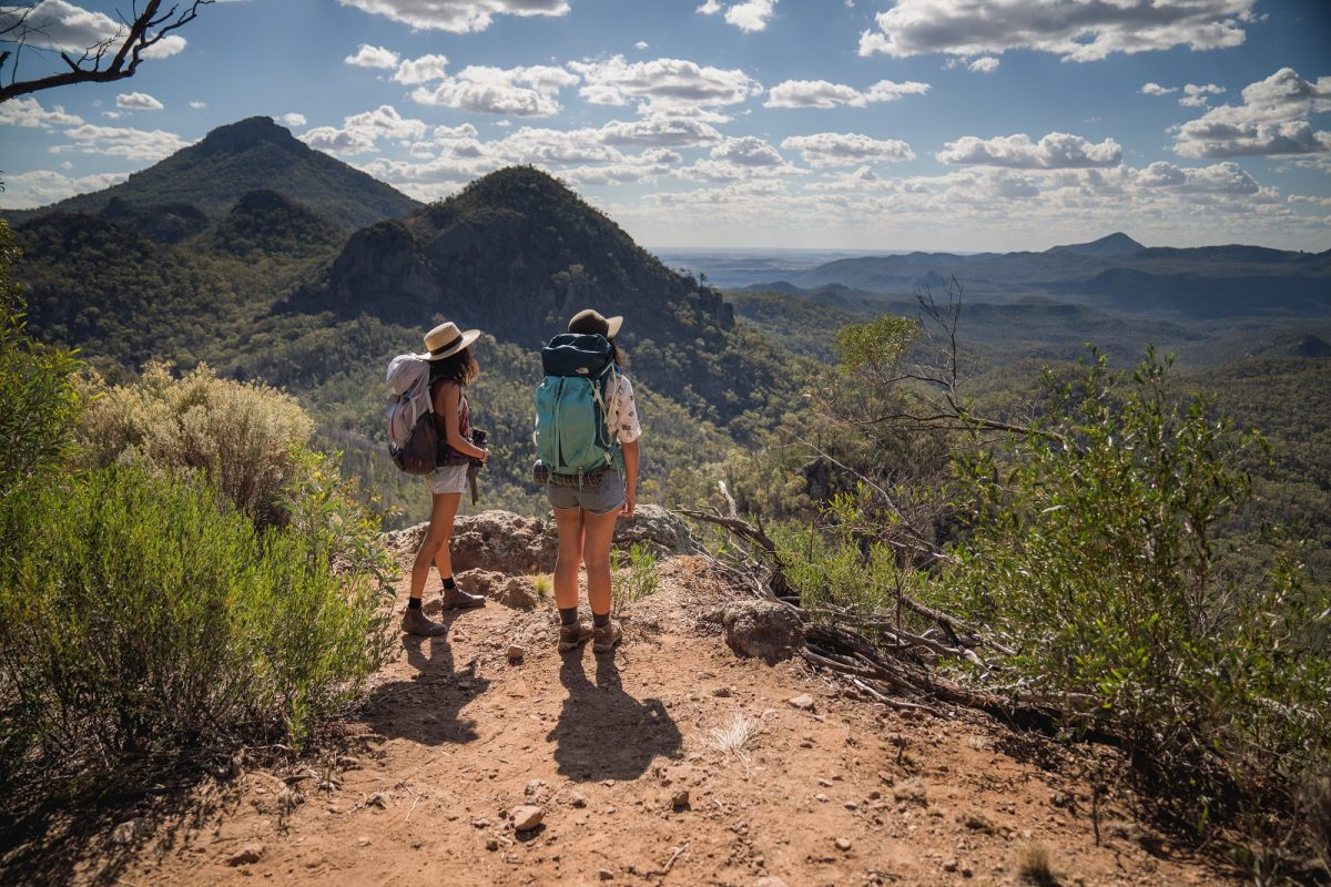 Two hikers on Breadknife and Grand High Tops walk in Warrumbungle National Park. Photo: Rob Mulally/OEH