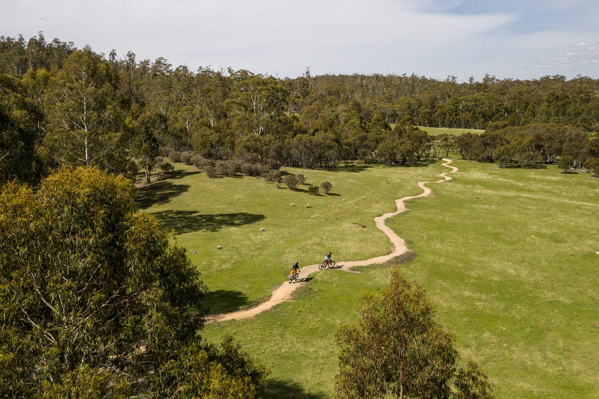 Aerial view of two guys riding the Thredbo Valley Track