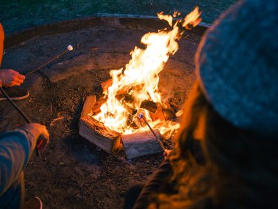 People toasting marshmallows around a fire at The Basin campground in Ku-ring-gai Chase National Park. Photo: Tim Clark