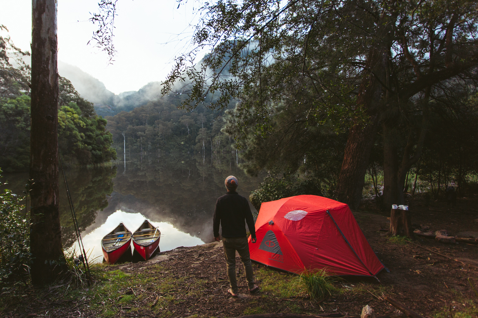 Person camping by the water, Morton National Park. Photo: Tim Clark