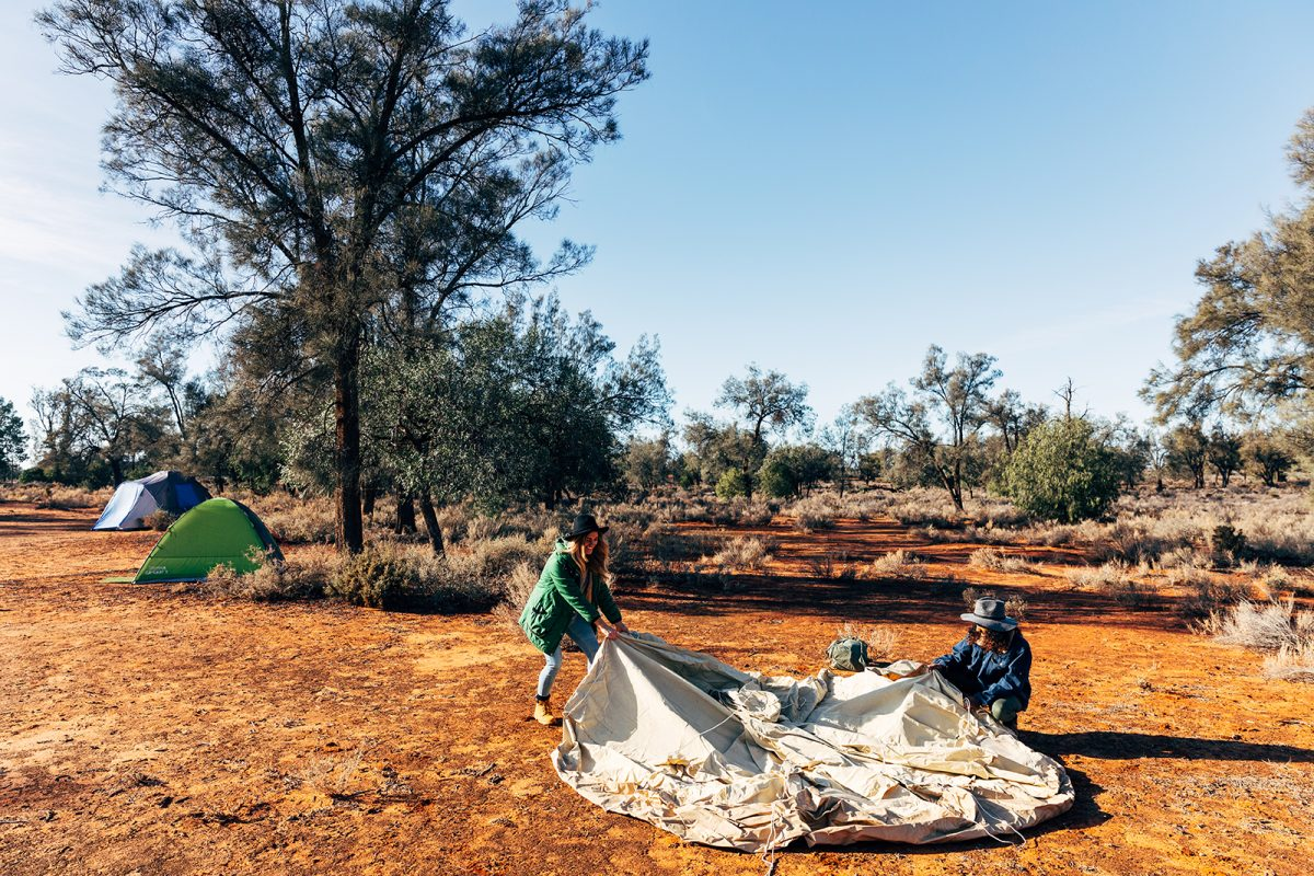 Two women setting up a tent at Main campground in Mungo National Park. Photo: Melissa Findley/OEH