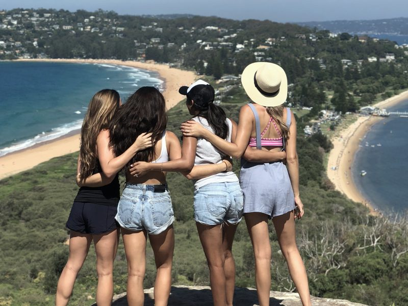 Group of people looking at towards Palm Beach from Barrenjoey Lighthouse. Photo: Jamie Kennedy