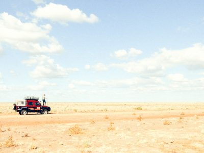 Person standing on a ute in an outback NSW national park. Photo: James Fyfe/DPIE