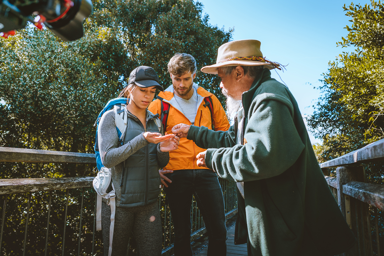 Uncle Mark Flandlers talking to a male and female in Dorrigo National Park