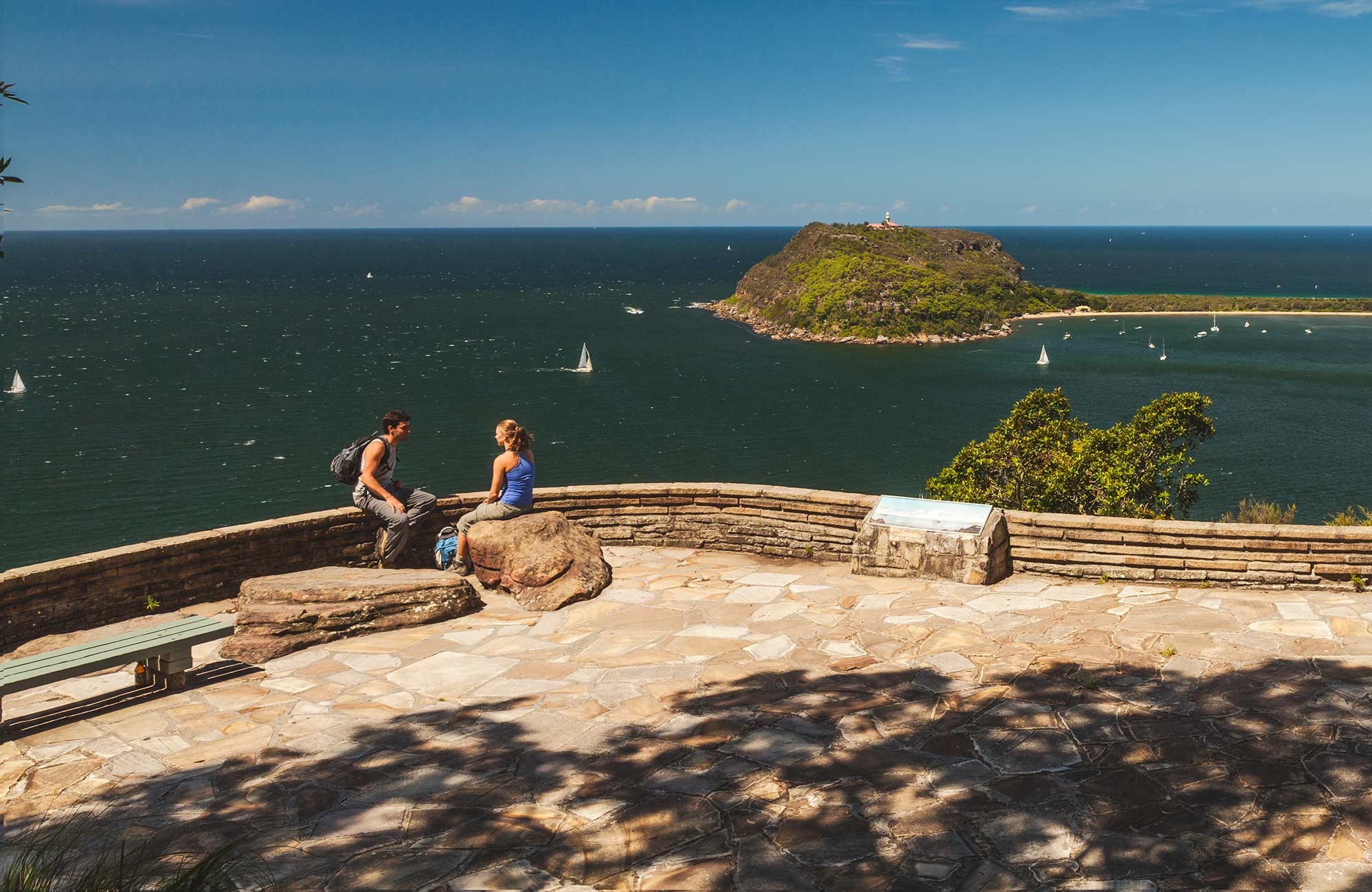 People enjoying the view out to sea from West Head lookout in Ku-ring-gai Chase National Park. Photo: David Finnegan/OEH