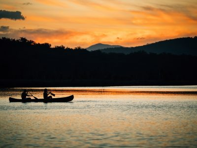 Two people canoeing at sunset in Murramarang National Park. Photo: Melissa Findley/DPIE