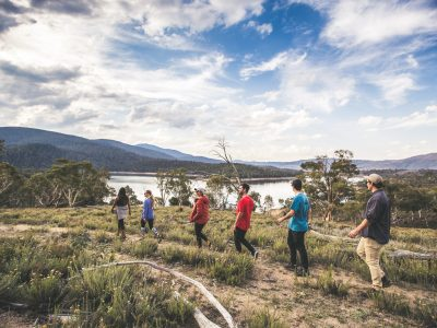 Group of people walking by Lake Jindabyne in Kosciuszko National Park. Photo: Boen Ferguson/OEH