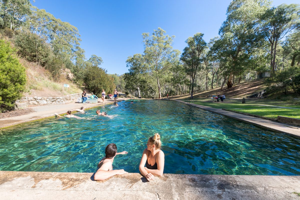 People relaxing at Yarrangobilly Caves thermal pool, Yarrangobilly area in Kosciuszko National Park. Photo: Boen Ferguson/DPIE