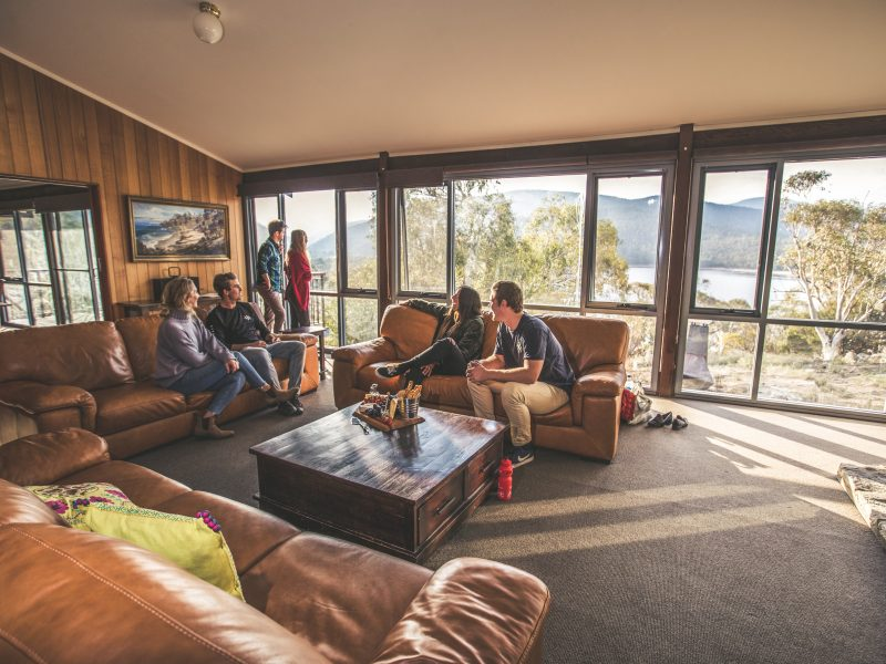 Group of people inside Creel Lodge in Kosciuszko National Park. Photo: Boen Ferguson/OEH