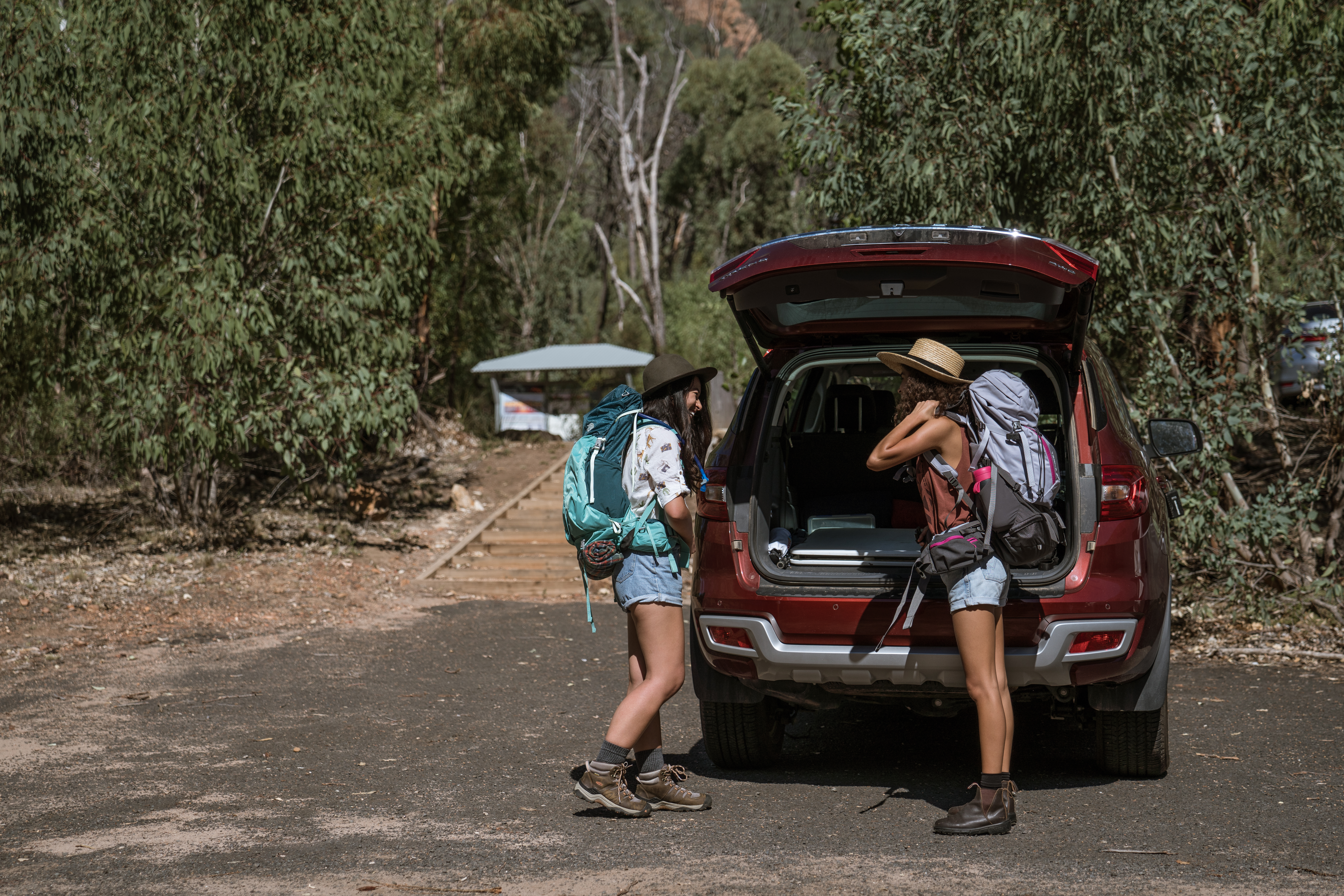 Two people preparing to go hiking in Warrumbungle National Park. Photo: Rob Mulally/OEH