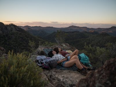 Couple relaxing at sunset in Warrumbungle National Park. Photo: Robert Mulally/DPIE