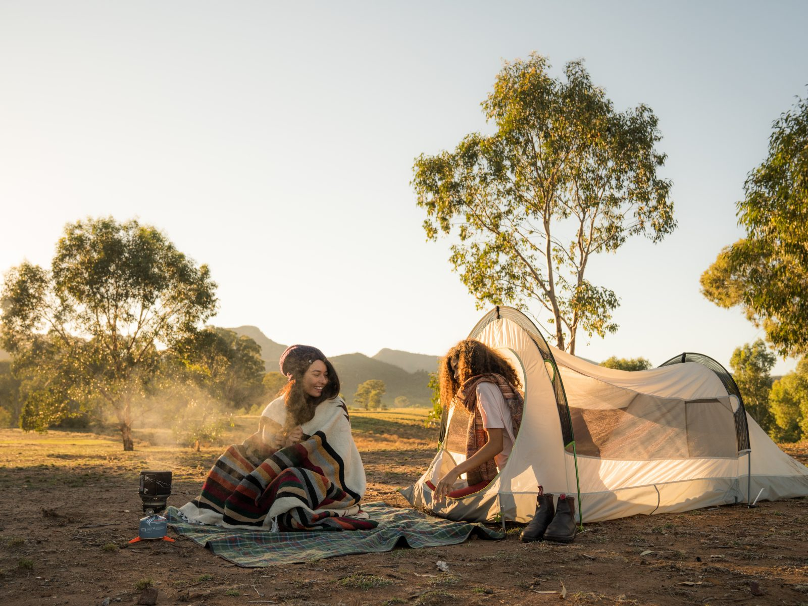 Two people at Camp Blackman in Warrumbungle National Park. Photo: Rob Mulally/OEH