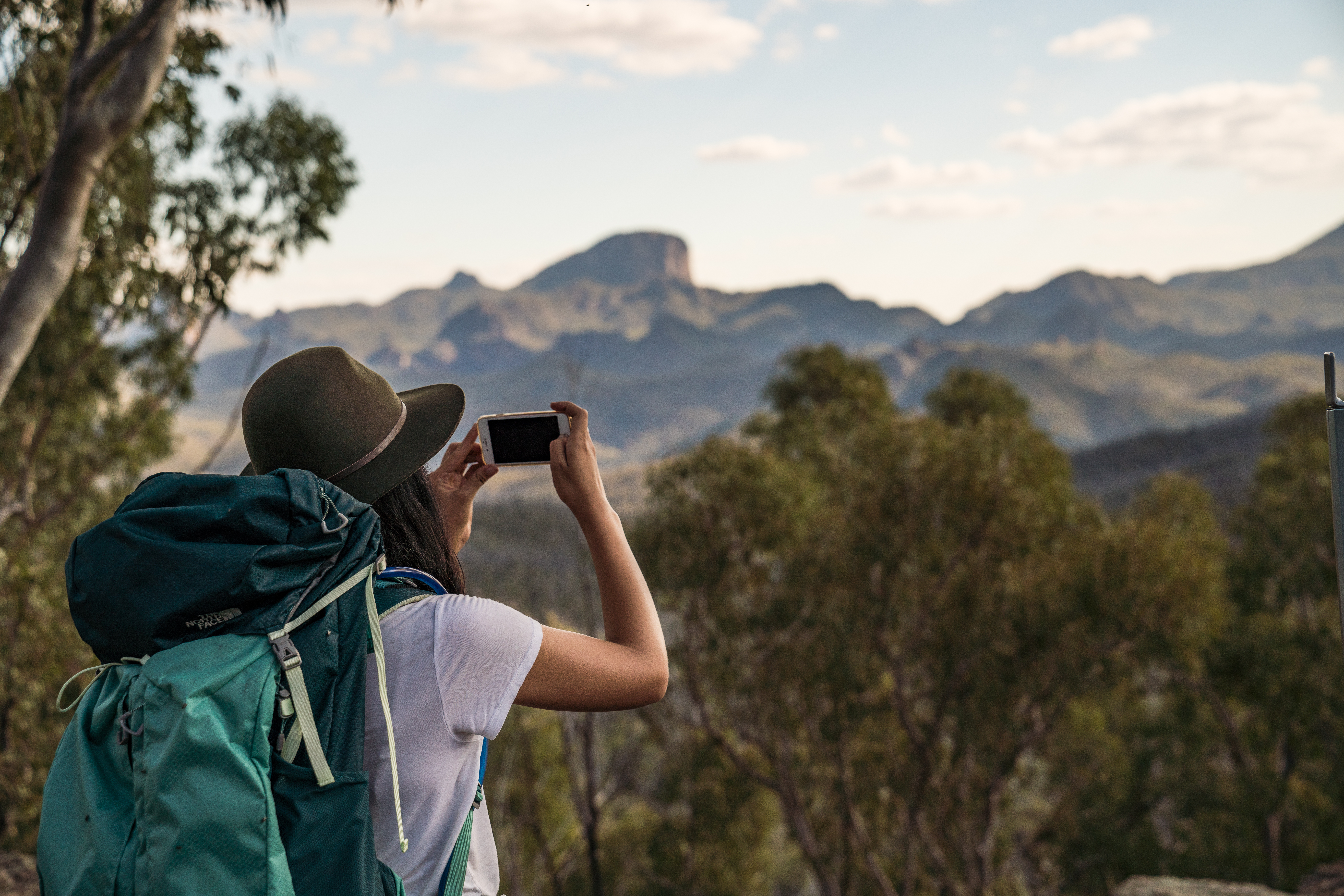 Hiker taking a photo in Warrumbungle National Park. Photo: Rob Mulally/OEH