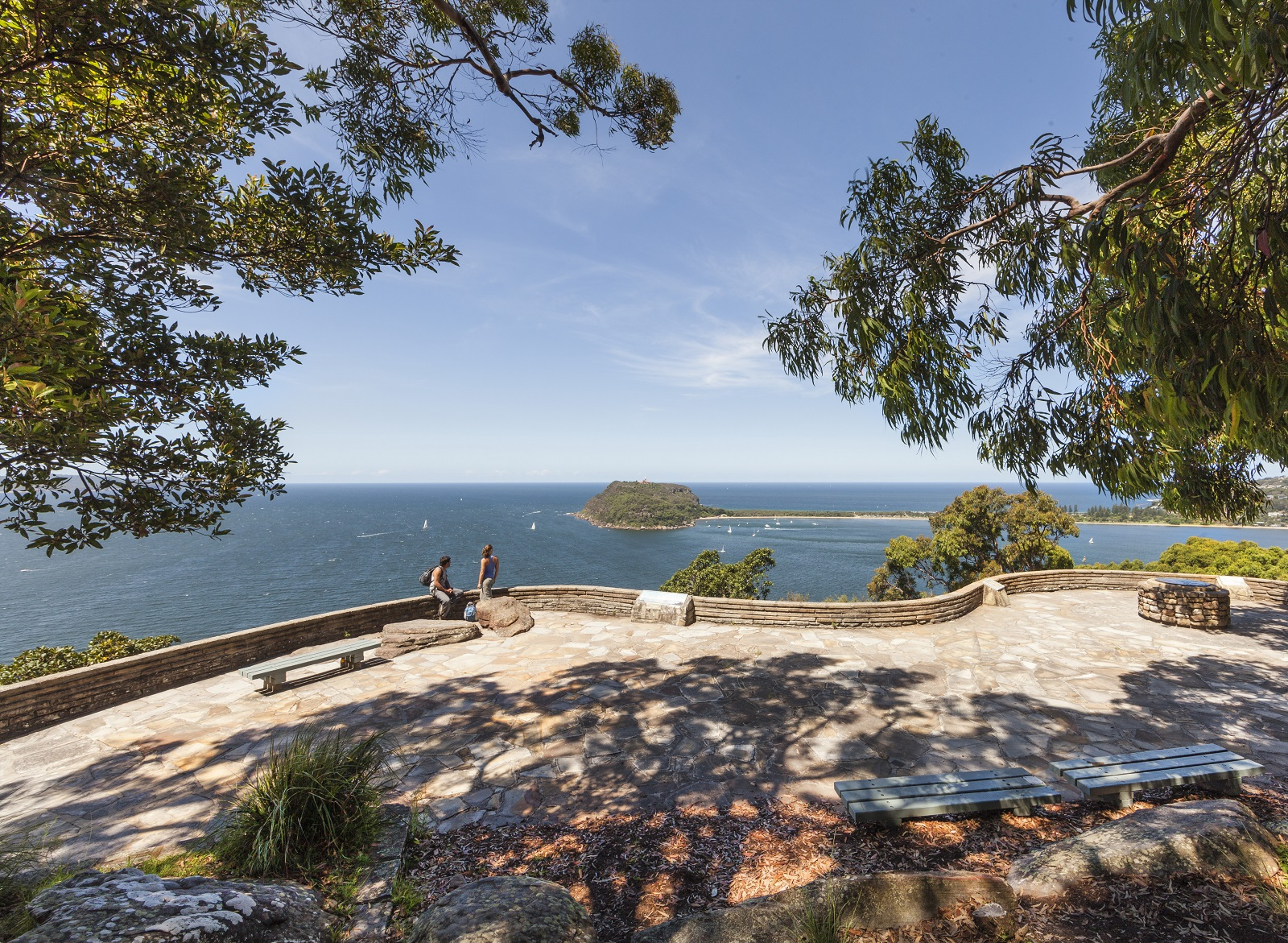 Two people enjoying scenic views from West Head lookout in Ku-ring-gai Chase National Park. Photo: David Finnegan/OEH