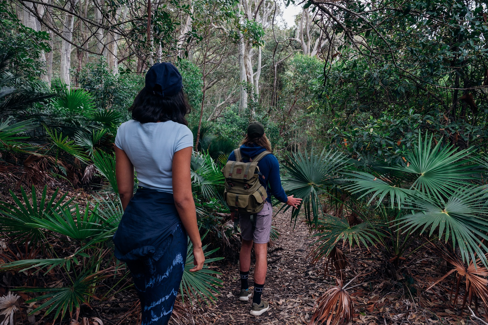 Two people walking through Murramarang National Park. Photo: Melissa Findley/OEH