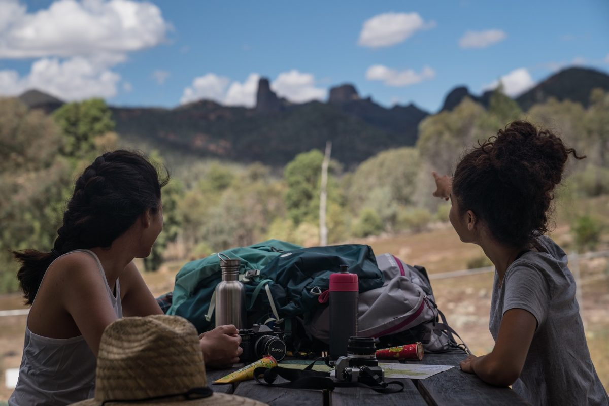 Two people resting on the Breadknife and Grand High Tops walk in Warrumbungle National Park. Photo: Rob Mulally/OEH