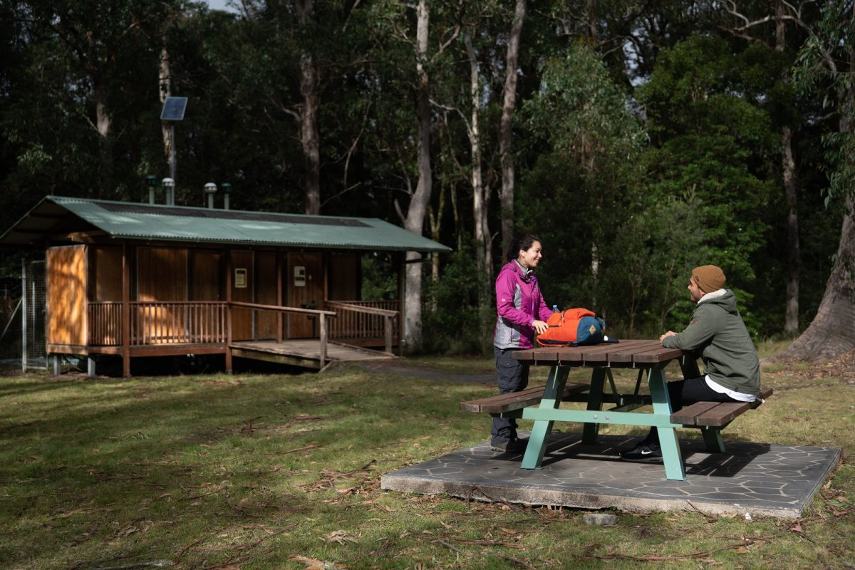 Couple resting at Honeysuckle picnic area in Barrington Tops National Park. Photo: Rob Mulally/OEH