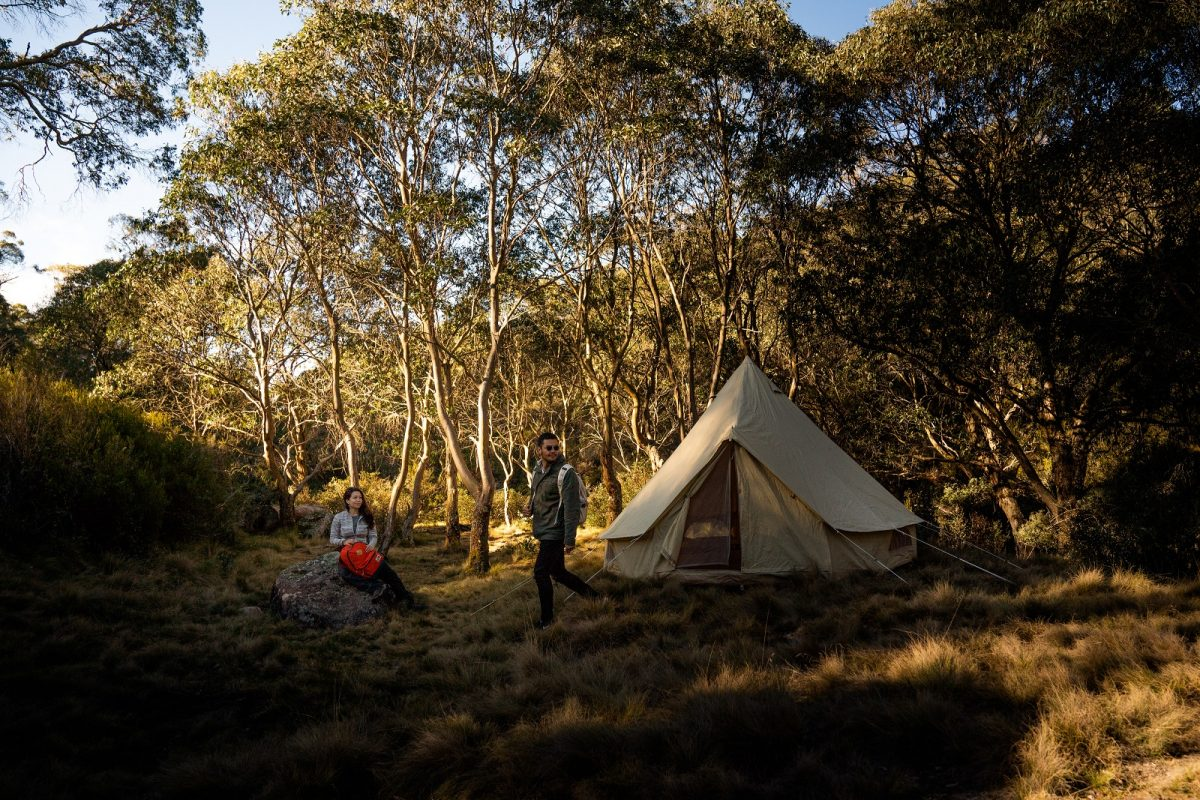 Two people near a tent at Junction Pools campground in Barrington Tops National Park. Photo: Rob Mulally/OEH