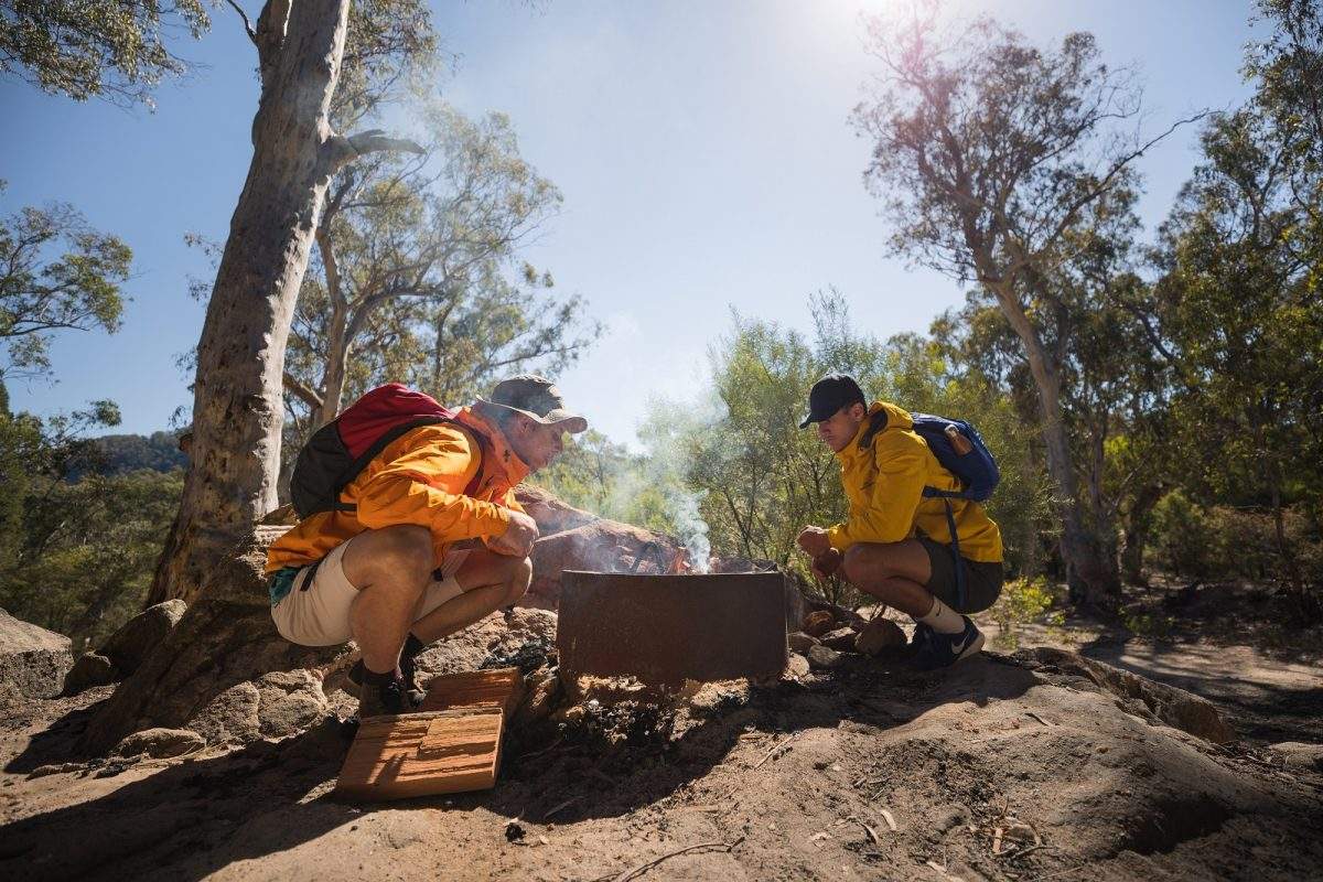 Two men around a campfire in Wollemi National Park. Photo: Daniel Tran/OEH