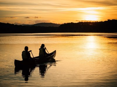 Silhouette of two people canoeing on a lake in Murramarang National Park. Photo: Melissa Findley/OEH