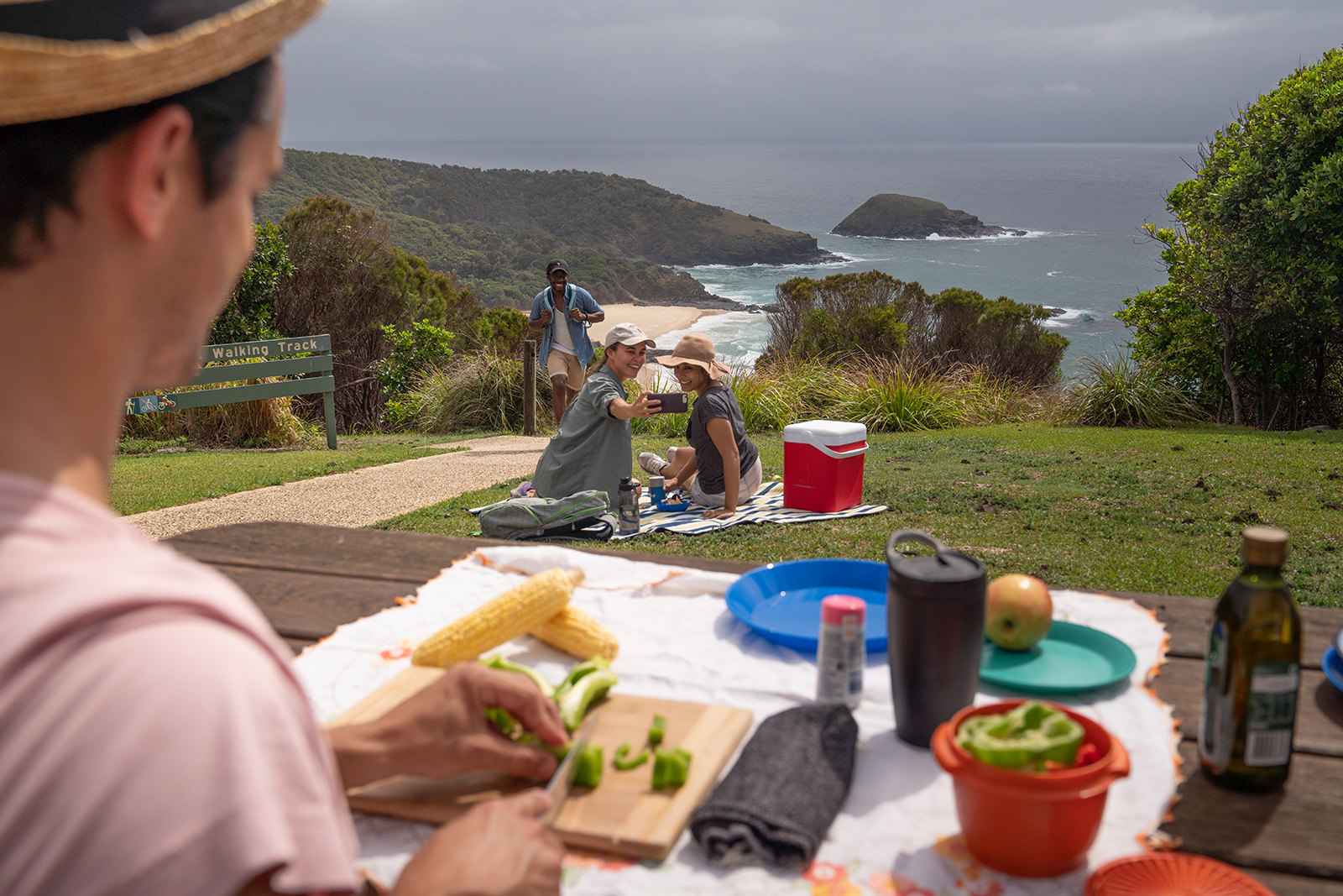 Group of people having a picnic at Hat Head National Park. Photo: Rob Mulally/DPIE