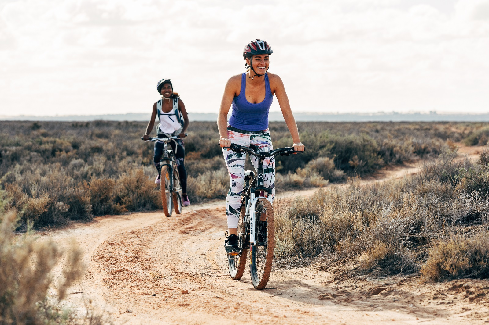 2 females on bikes on the self-guided drive tour in Mungo National Park