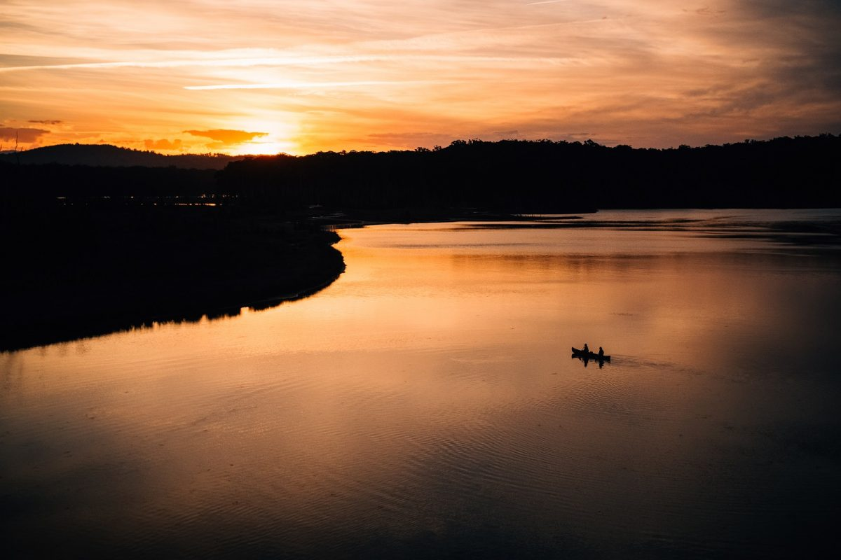 Canoeing into the sunset on Durras Lake in Murramarang National Park. Photo: Melissa Findley/OEH