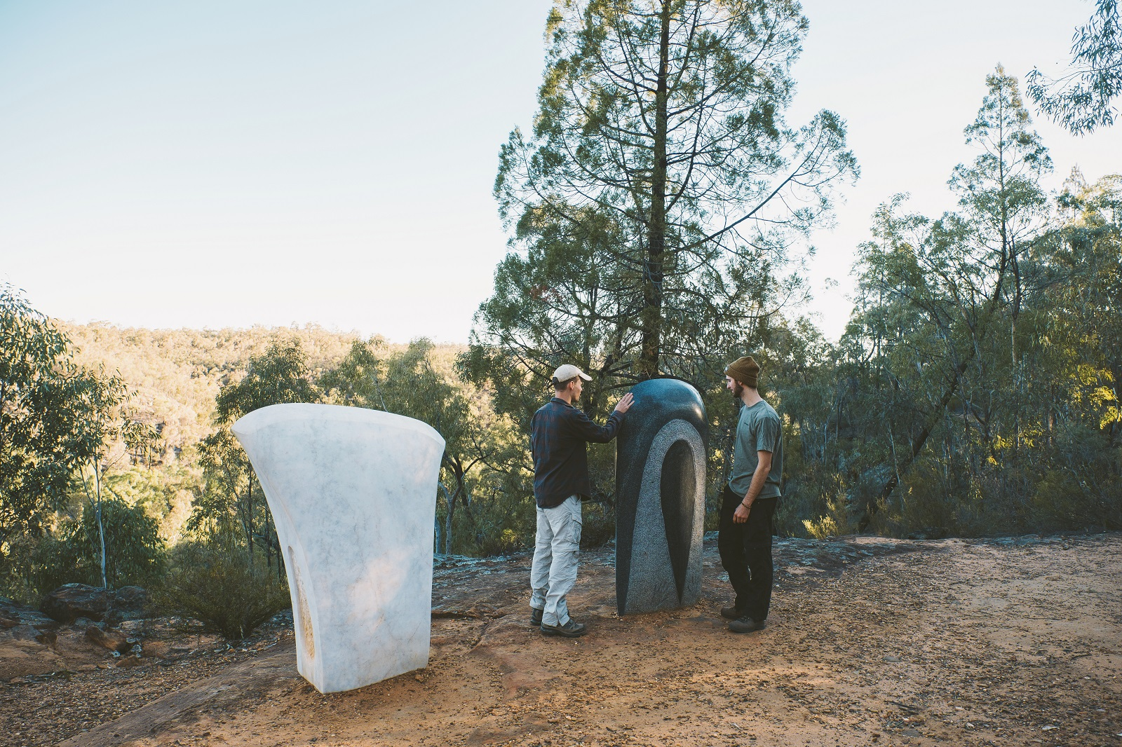 Two men admiring the sculptures on the Sculptures in the Scrub walking track in Timmallallie National Park. Photo: Harrison Candlin/OEH