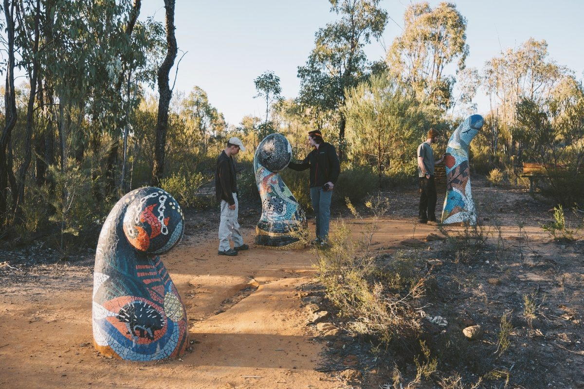 People admiring sculptures along the Sculptures in the Scrub walking track. Photo: Harrison Candlin/OEH