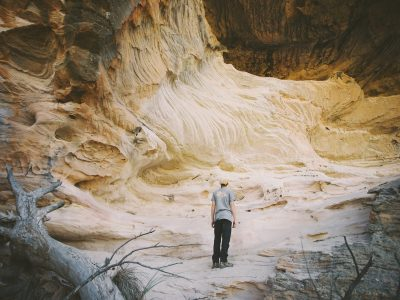 A man looking at the Sandstone Caves in Pilliga Nature Reserve. Photo: Harrison Candlin/OEH