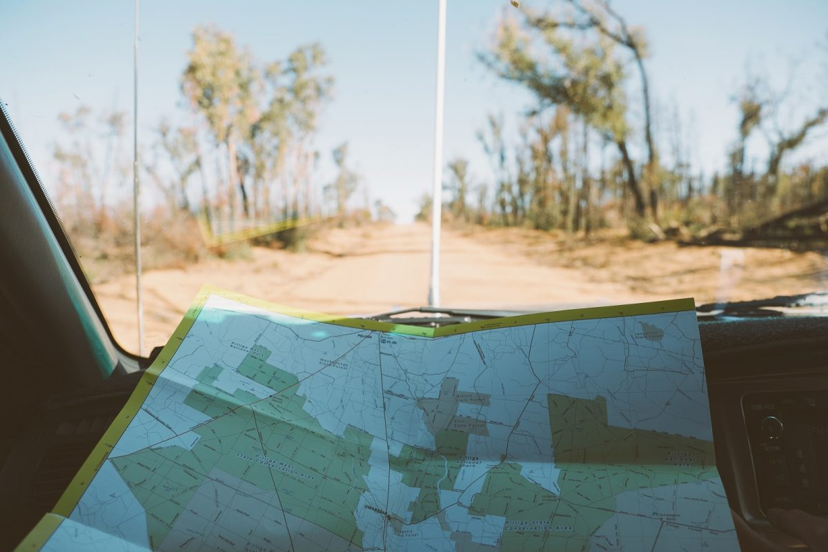 Viewing a map on a road trip to the Pilliga. Photo: Harrison Candlin/OEH