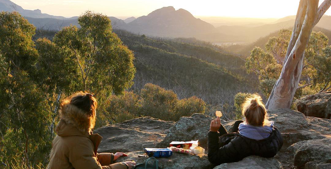 Two people having a sunset snack in a NSW national park. Photo: Chloe Kafte